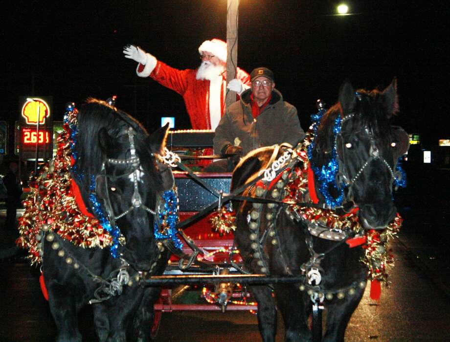 As anticipated, Santa was the last float in this year's Bad Axe Christmas Parade on Saturday. Santa chose to come in a horse-drawn wagon to the parade because, obviously, Rudolph doesn't like dry pavement. This year's grand marshals were Dave and Mary Rapson, owners of Rapson Refrigeration. Parade coordinator, Kelsey Brown, said they were an obvious choice and the couple has given back to the community for many years. Photo: Rich Harp/For The Tribune
