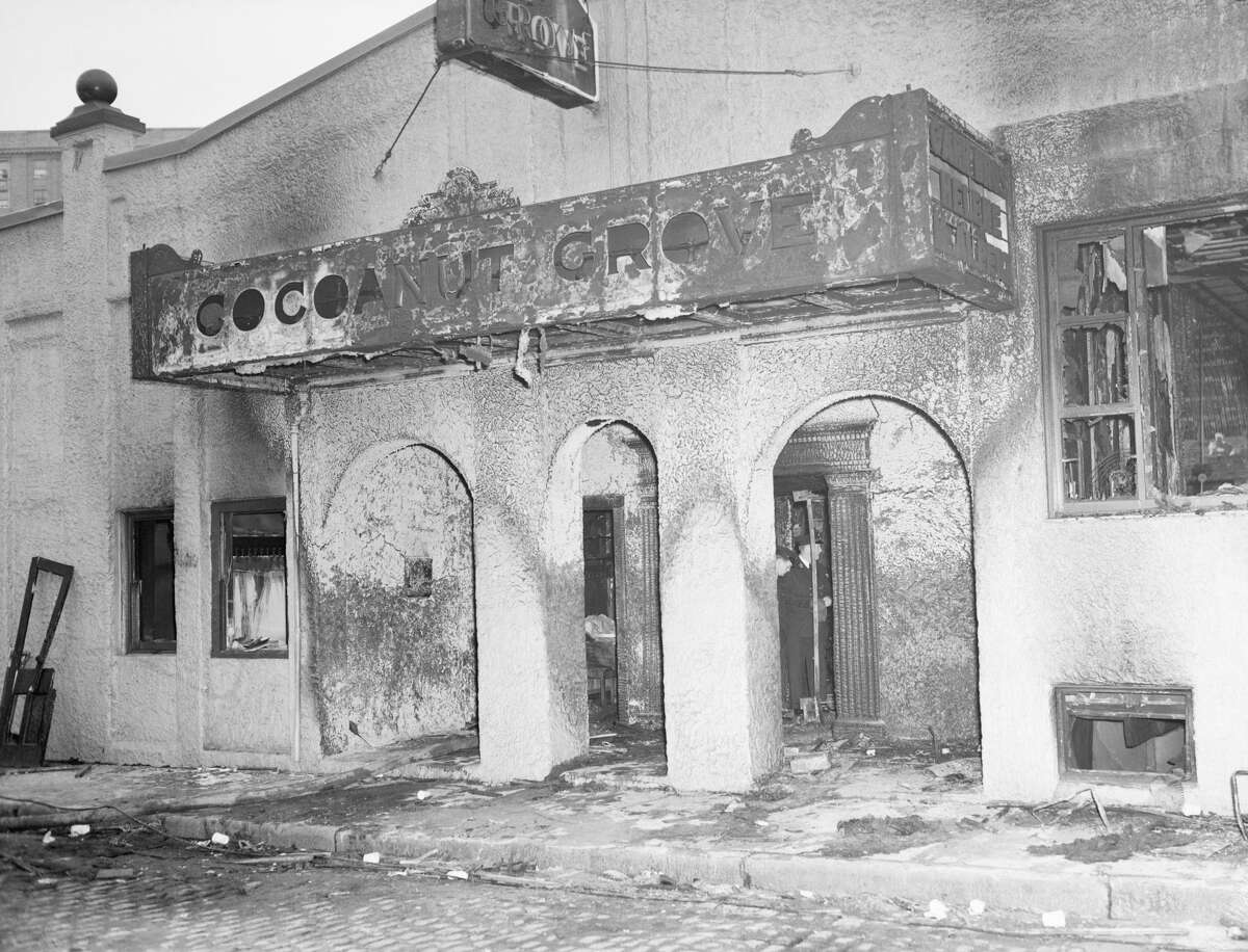 Cocoanut Grove, Boston - Nov. 28, 1942; 492 killed Firemen (rear) view the remains of Boston's Cocoanut Grove night club through the revolving doors leading to the tiny 10-foot-wide vestibule where stampeding guests were crushed and smothered as they tried to leave the burning club.