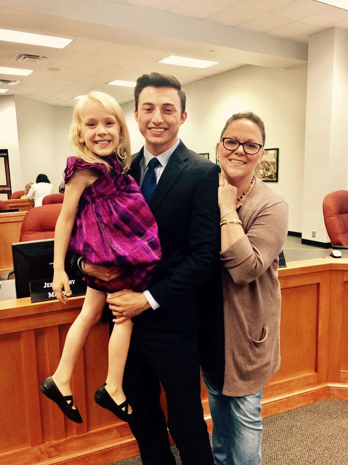 """Pearland school trustee Mike Floyd holds 6-year-old Kai Shappley alongside Kai's mother, Kimberly Shappley. Floyd's campaign featured pro-LGBT positions. """"I am a firm believer that trans students should be able to use the restroom they identify with,"""" Floyd says."""