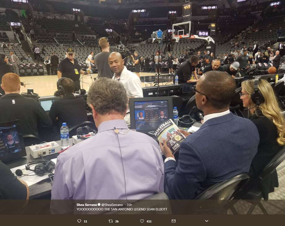 Former Spur and analyst Sean Elliott reading San Antonio native Shea Serrano's Basketball (And Other Things) Photo: Twitter.com