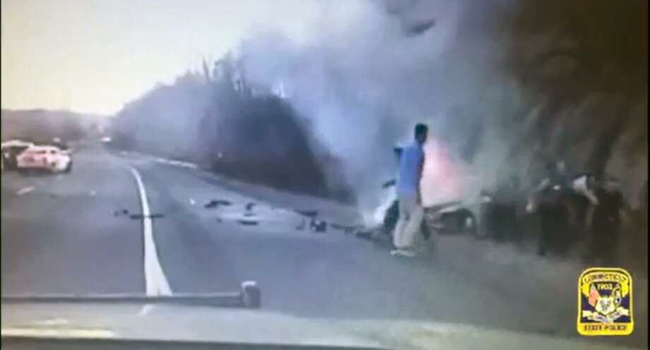 Video footage of State Troopers and passing motorists making a daring rescue on Interstate 84  in Middlebury on Monday Nov. 27, 2017,  pulling a New York man from a burning car.  The incident was caught on the trooper's dash camera and was released by the State Police. Photo: CT State Police / Contributed Photo / Connecticut Post Contributed