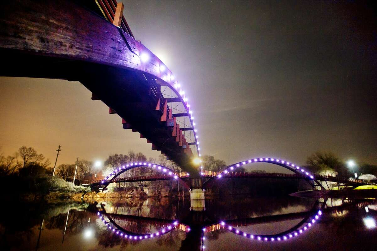 Brand new LED lights illuminate the Tridge on Monday, Nov. 27, 2017. The lights have the ability to change color for special occasions and holidays. (Katy Kildee/kkildee@mdn.net)