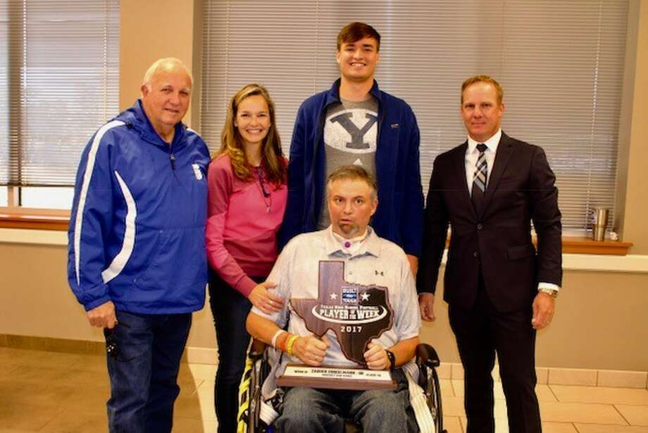 Pictured in the photo from left to right are: Sonny Detmer, Somerset High School Football Coach, Dee Detmer-Dinkelmann and Johan Dinkelmann (seated), Zadock's parents; Zadock Dinkelmann, Built Ford Tough Texas High School Football Player of the Week Class 4A for Week 10; David Dove, Mac Haik's Southway Ford General Manager (Photo courtesy of Somerset ISD)