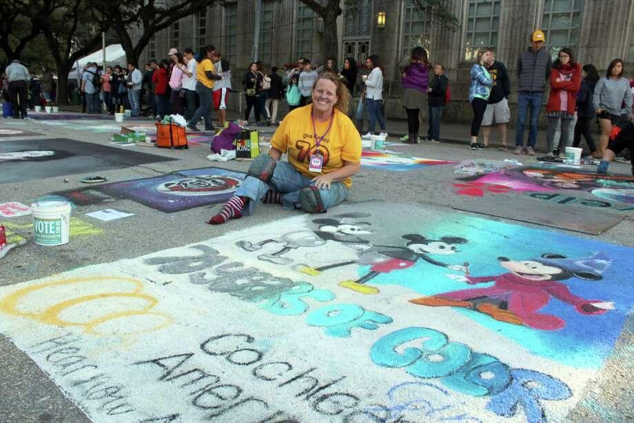 Sugar Land artist Gini Bailey helped raise donations fornonprofit The Center for Hearing and Speech through the Houston Via Colori Street Painting Festival. Photo: Kristi Nix / Houston Chronicle