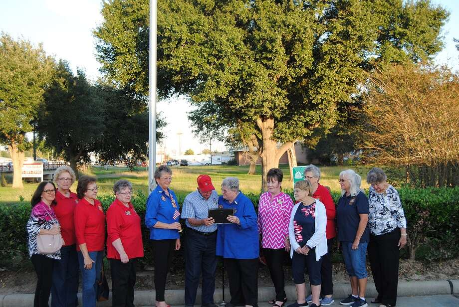 Veterans of Foreign Wars Auxiliary Post 9182 presented their first Americanism Award to Herman Meyers, owner of Midway Barbeque, for his willingness to promote patriotism and Americanism by showing his pride in flying the American flag continuously. The Auxiliary plans to present this award monthly to a small business in the Katy area that promotes patriotism and Americanism by flying the American flag. Photo: Courtesy Photo
