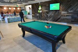 A pool table is part of the break room at the recently opened offices of television provider Hulu.
