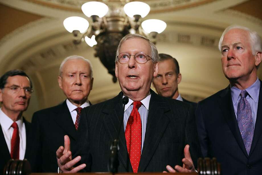 Majority Leader Mitch McConnell (center) is joined by fellow Republican senators as he speaks with reporters at the Capitol about plans to vote on tax-overhaul legislation this week. Photo: Chip Somodevilla, Getty Images