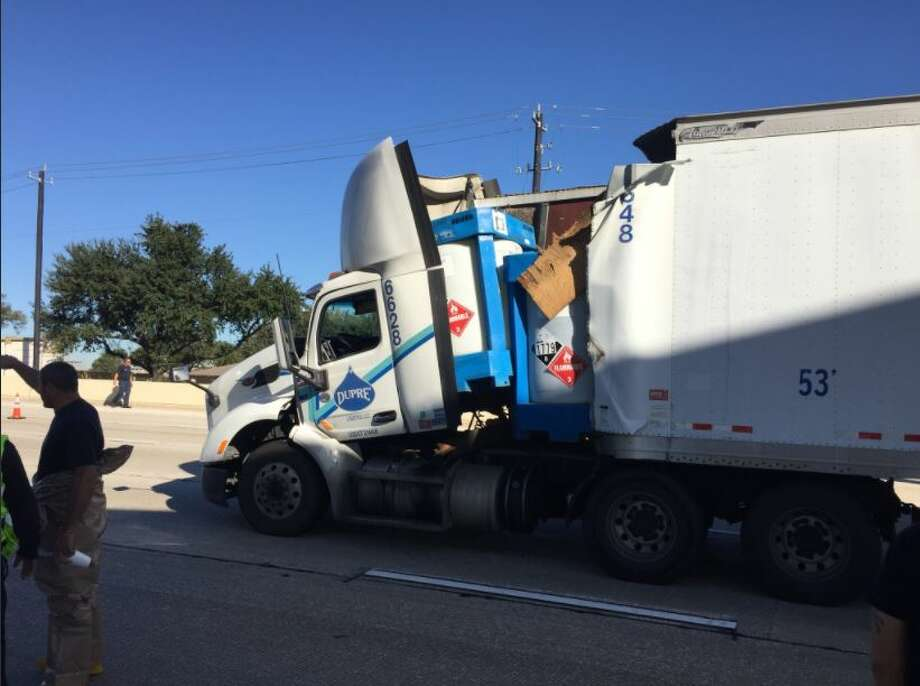 An 18-wheeler carrying sulfuric acid crashed Tuesday on Interstate 10, shutting down westbound lanes of the highway for hours.