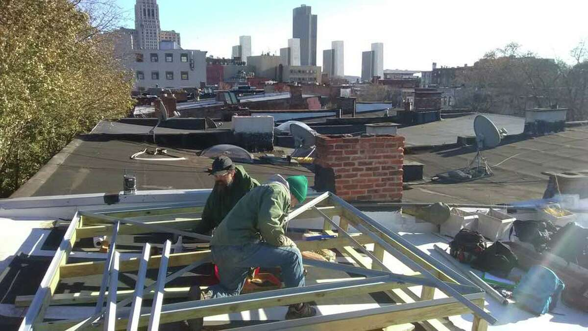 The broadcast tower for WOOA-FM goes up last week on the roof of the Social Justice Center in Albany ORG XMIT: UlmFlTHAr6l51KLJ5z39
