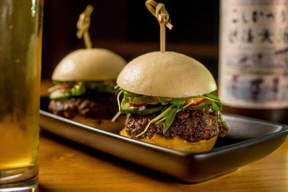 The Umami Sliders with a beer at Mamanako in San Francisco, Calif. are seen on November 25th, 2017.