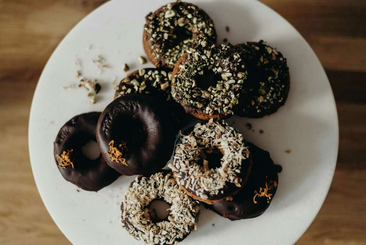 Kim Milea recently launched her own business, Crumz, selling paleo doughnuts that are also free of gluten, dairy and refined sugar. The donuts pictured are almond coconut and ginger pistachio, two popular flavors.