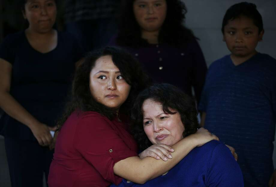 Vianney Sanchez, 23 (left), comforts her mother, Maria Mendoza-Sanchez, after the family met with Sen. Dianne Feinstein. Photo: Leah Millis, The Chronicle