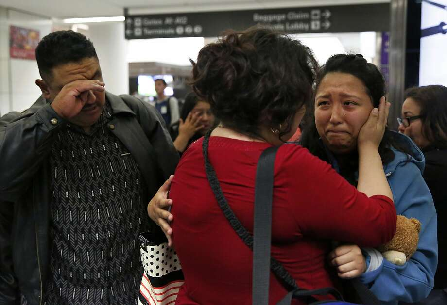 Maria Mendoza-Sanchez says her final words of good bye while holding her daughter Melin, 21, as her husband Eusebio tries to keep his composure as they leave for their self-deportation flight back to Mexico from San Francisco International Airport August 16, 2017 in San Francisco, Calif. The family's application for a stay was denied. Photo: Leah Millis / The Chronicle