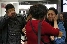 Maria Mendoza-Sanchez says goodbye to her daughter Melin, 21, as her husband, Eusebio, tries to keep his composure as they leave for Mexico from San Francisco International Airport. The parents' application for a stay was denied.