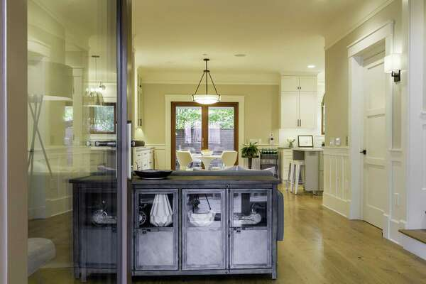 The open kitchen features hardwood flooring and exterior access.