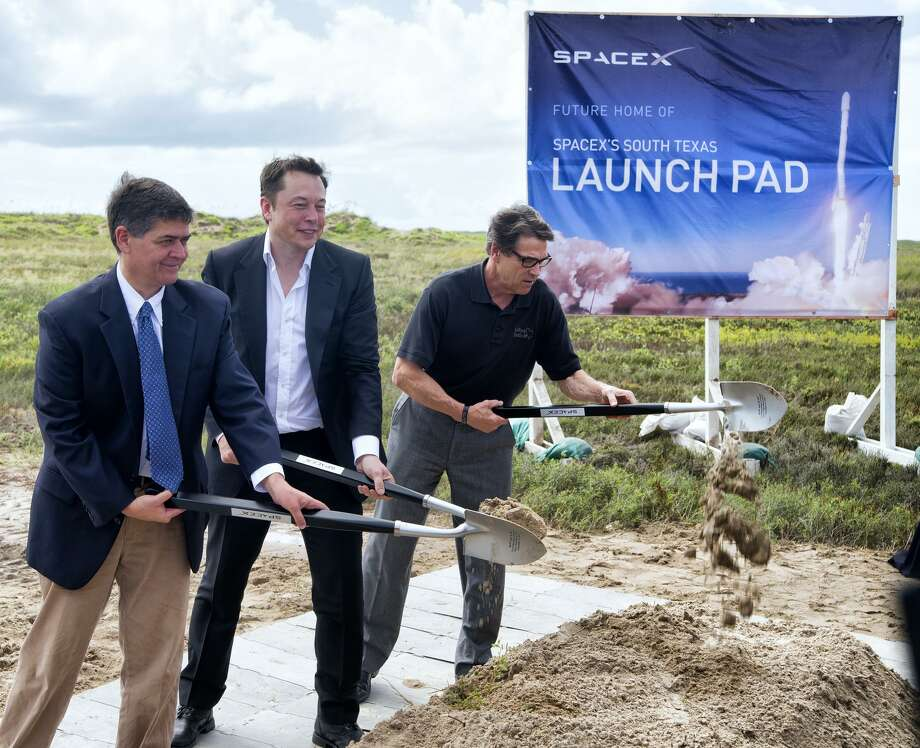 File photo of the 2014 groundbreaking ceremony for the SpaceX launch pad at Boca Chica Beach. U.S. Rep. Filemon Vela, left, SpaceX founder and CEO Elon Musk, center, and Texas Gov. Rick Perry turn the first shovel-full of sand. Photo: David Pike /Associated Press / Valley Morning Star