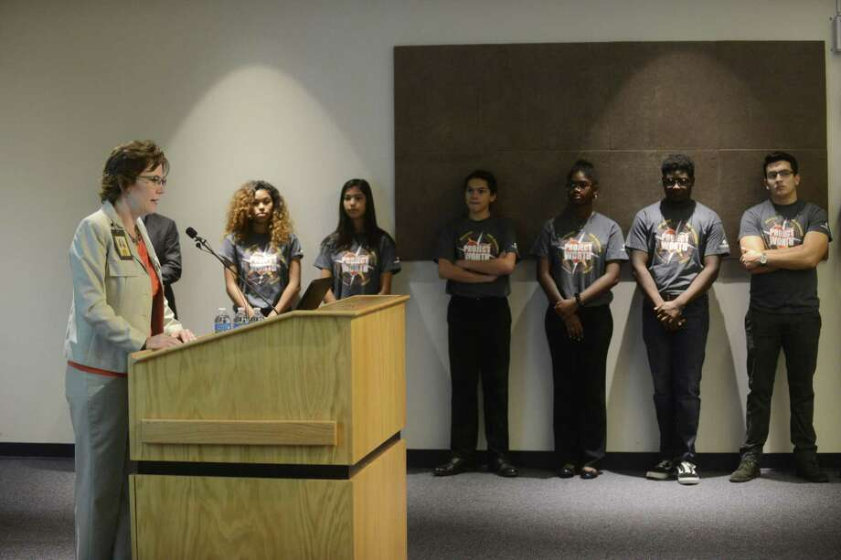 Colleen M. Bridger, director of the Metropolitan Health District, speaks about the most recent teen birth rates as members of Project Worth, a group of young people who did research on the issue, listen on Nov. 28, 2017 Photo: Billy Calzada /San Antonio Express-News / San Antonio Express-News
