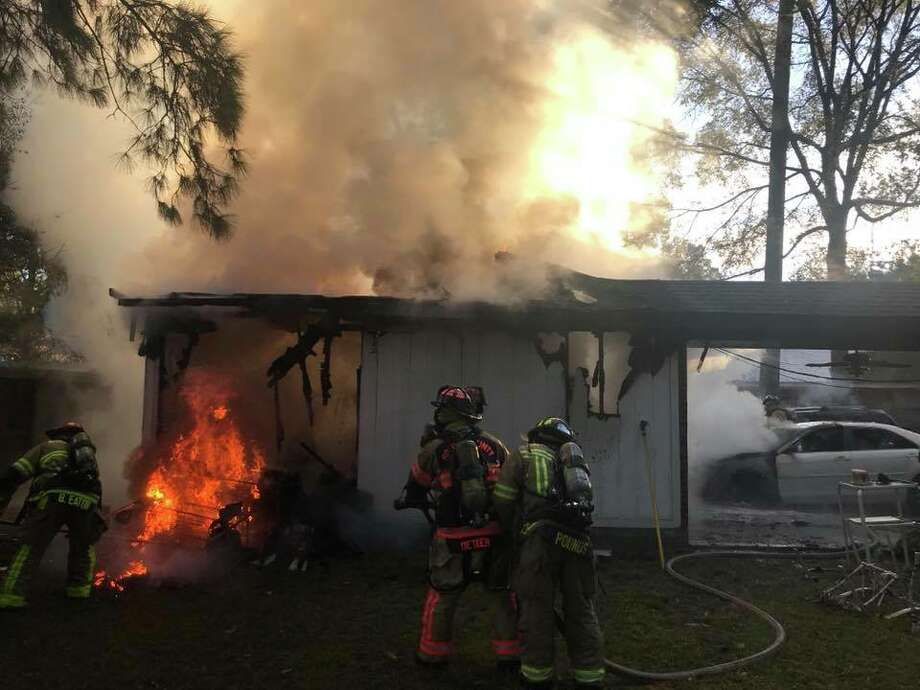 Firefighters were called out to a home in the 100 block of Pine Manor Drive around 7:30 a.m. on Friday, Nov. 24, 2017, to reports of a car fire inside a detached garage. When they got on scene, they found the garage fully engulfed in flames that were threatening nearby homes. Photo: Courtesy The Woodlands Professional Fire Fighters Association