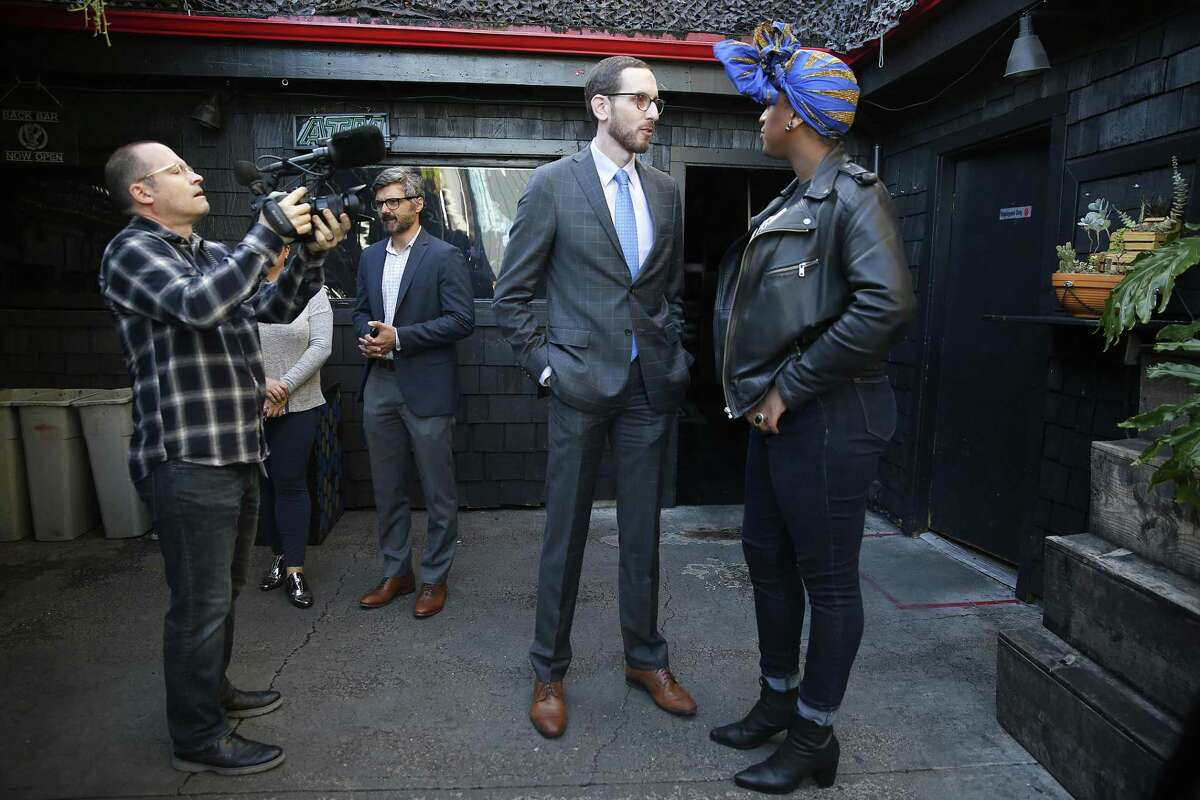 Senator Scott Wiener (middle) talks with Honey Mahogany (right) after announcing a bill that would allow bars to stay open until 4am is being reintroduced at San Francisco Eagle bar on Tuesday, November 28, 2017, in San Francisco, Calif. At left is state senate media producer Richard Enos.