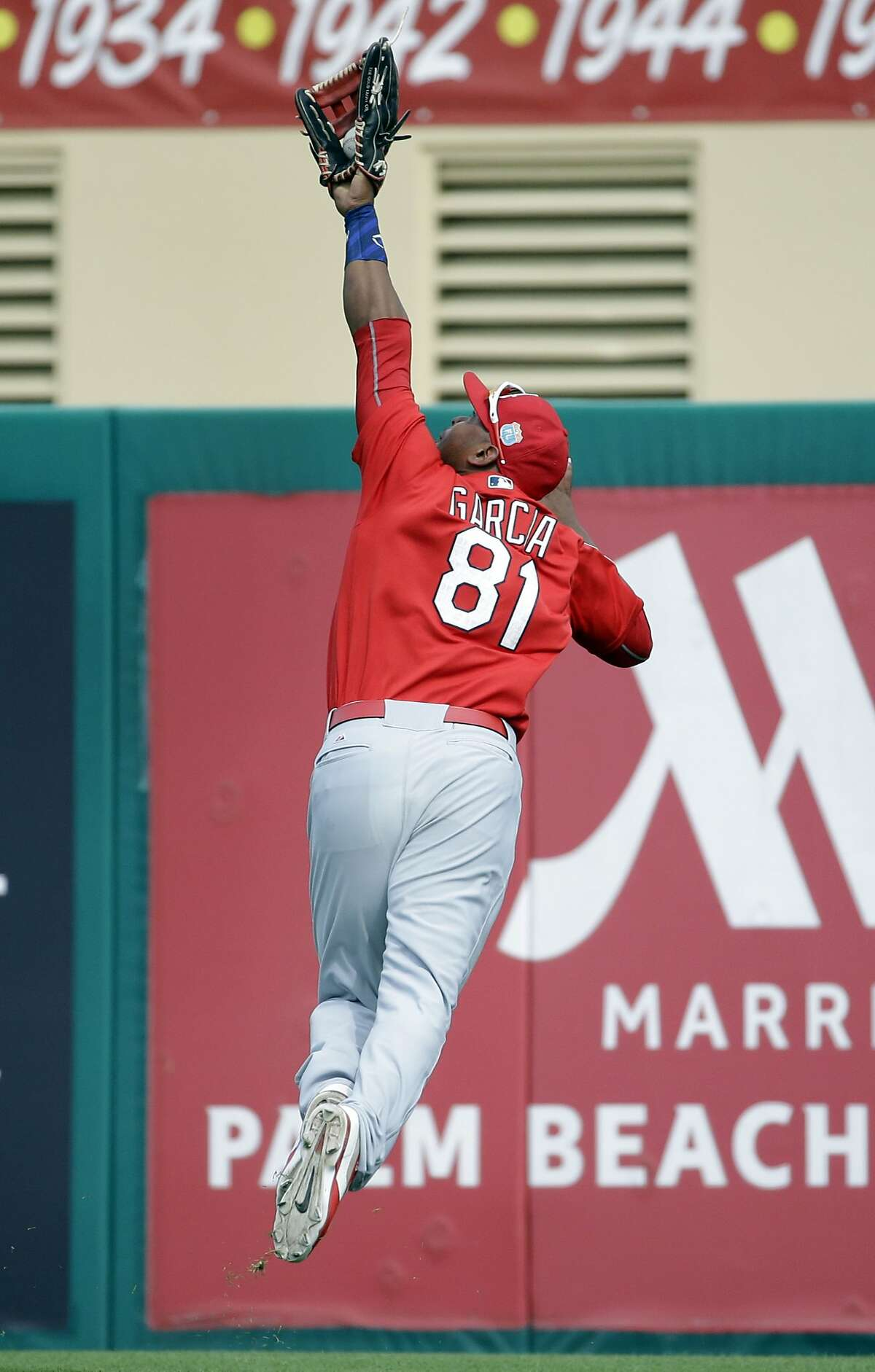 St. Louis Cardinals right fielder Anthony Garcia leaps into the air to catch a ball hit by Miami Marlins' Dan Black for an out during the sixth inning of an exhibition spring training baseball game Saturday, March 5, 2016, in Jupiter, Fla. (AP Photo/Jeff Roberson)
