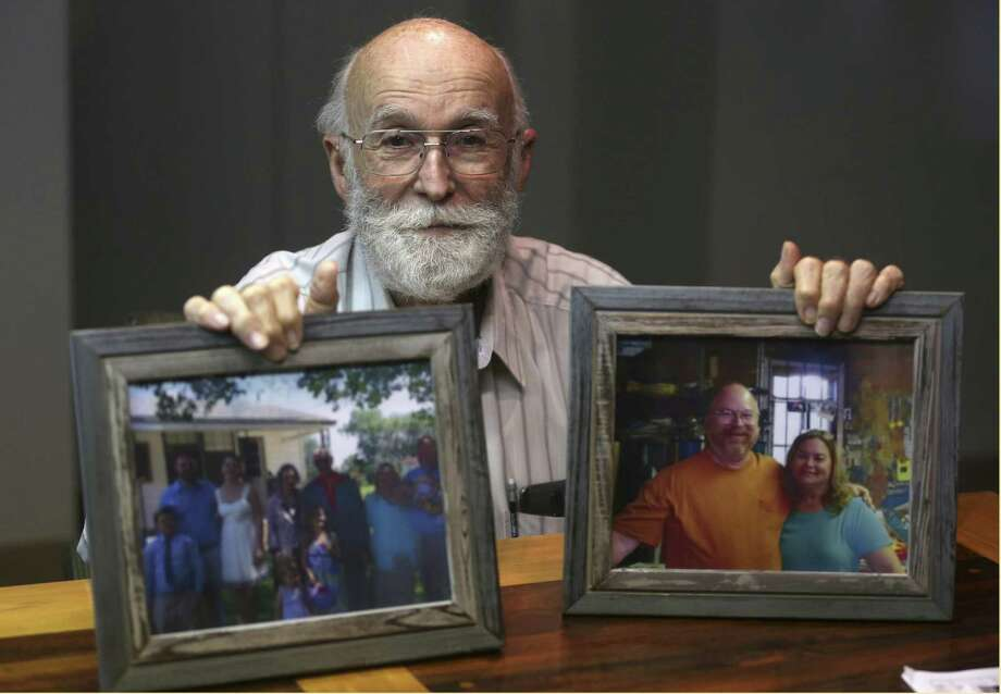 Joe Holcombe holds photos of his family Tuesday, Nov. 28, 2017 showing some of the people killed in the Sutherland Springs First Baptist Church shooting. Holcombe and his wife, Claryce, filed an administrative claim against the federal government Tuesday. An administrative claim in the first step before someone can file a lawsuit against the government. Photo: William Luther, Staff / San Antonio Express-News / © 2017 San Antonio Express-News