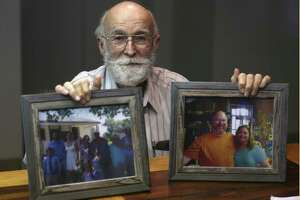 Joe Holcombe holds photos of his family Tuesday, Nov. 28, 2017 showing some of the people killed in the Sutherland Springs First Baptist Church shooting. Holcombe and his wife, Claryce, filed an administrative claim against the federal government Tuesday. An administrative claim in the first step before someone can file a lawsuit against the government.
