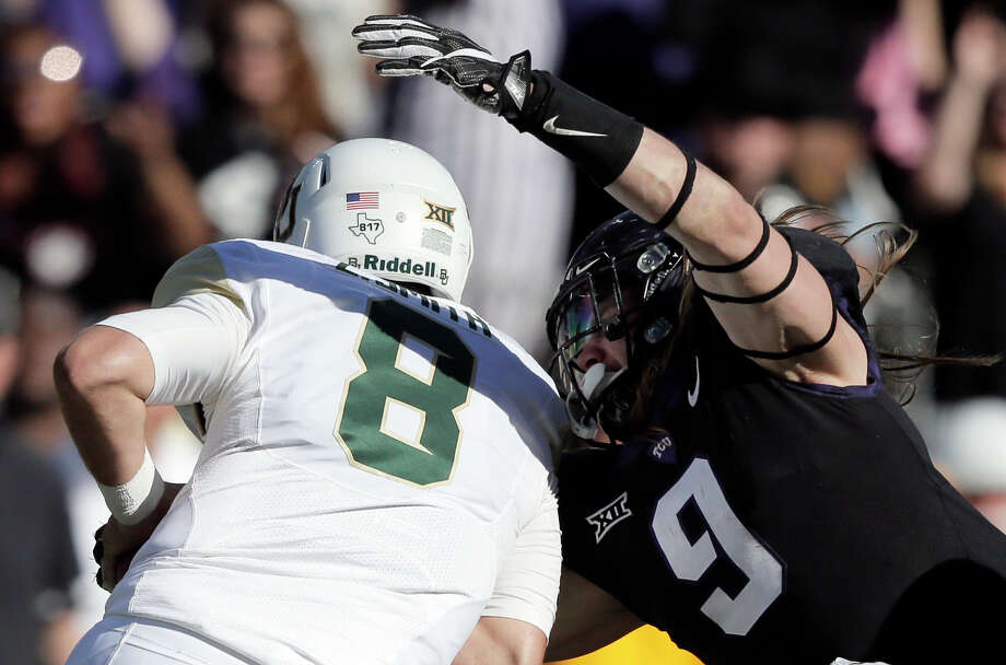 FILE - In this Nov. 24, 2017, file photo, TCU defensive end Mat Boesen (9) sacks Baylor quarterback Zach Smith (8) during the second half of an NCAA college football game, in Fort Worth, Texas. The No. 10 Horned Frogs hope to have Boesen back for an entire game in the rematch against the No. 2 Sooners, this time in the Big 12 championship game Saturday that comes a week after his TCU single-game record 5 1/2 sacks against Baylor. (AP Photo/Brandon Wade, File) Photo: Brandon Wade, FRE / FR168019 AP