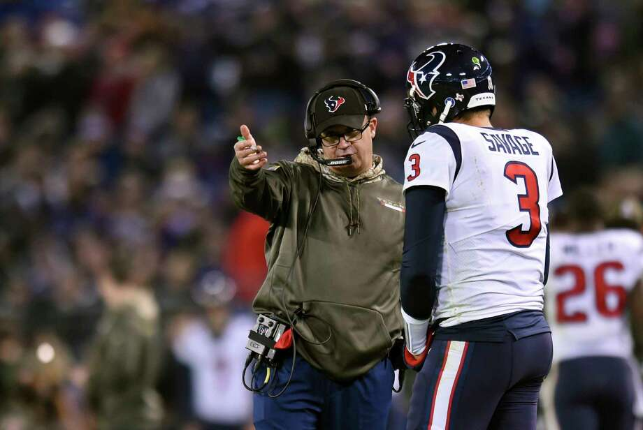 Houston Texans head coach Bill O'Brien, left, speaks with quarterback Tom Savage in the first half of an NFL football game against the Baltimore Ravens, Monday, Nov. 27, 2017, in Baltimore. (AP Photo/Gail Burton) Photo: Gail Burton, FRE / FR4095 AP