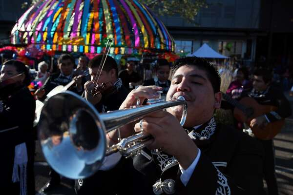 Sergio Martinez of Mariachi Aguila, from Brackenridge High School, performs during the inaugural Tamales! Holiday Festival.