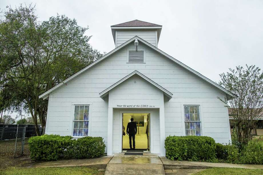 First Baptist Church in Sutherland Springs, which has been transformed into a memorial to honor those who died there after a gunman opened fire during a service, killing 26 people, in Texas, Nov. 12. Photo: Drew Anthony Smith / The New York Times / NYTNS