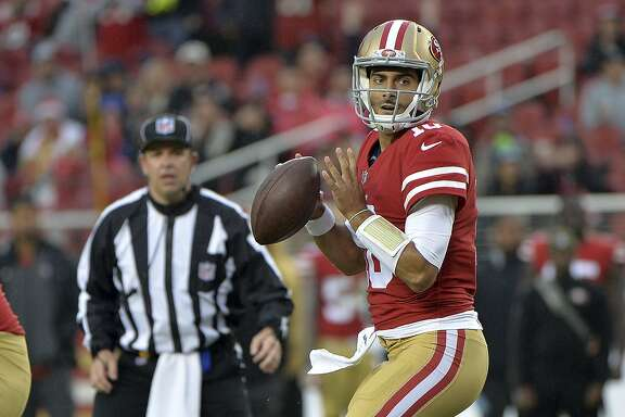 San Francisco 49ers quarterback Jimmy Garoppolo looks to throw against the San Francisco 49ers during the second half of an NFL football game Sunday, Nov. 26, 2017, in Santa Clara, Calif. (AP Photo/Don Feria)