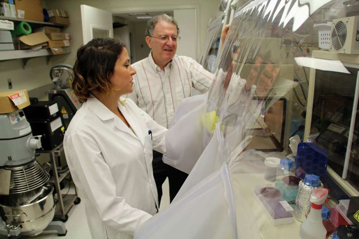 At the Washington University School of Medicine in St. Louis, Dr. Jeffrey Gordon and graduate student Vanessa Ridaura examine samples of gut bacteria taken from fat or lean people in 2013. Such research on obesity might be thwarted if fewer graduate students exist because their tuition aid will be taxed.