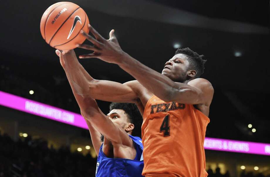 Duke's Marvin Bagley III (35) and Texas' Mohamed Bamba (4) go after a rebound during the second half of the game during the PK80-Phil Knight Invitational at the Moda Center on Nov. 24, 2017 in Portland, Oregon. Duke won 85-78. Photo: Steve Dykes /Getty Images / 2017 Getty Images