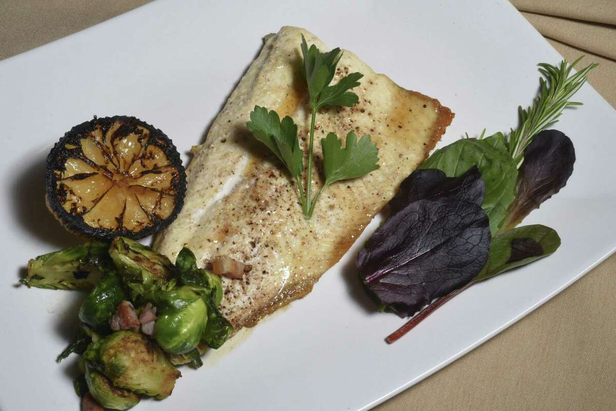 Idaho trout with hazelnut, brown butter and pancetta and roasted Brussels sprouts at Rossini Italian Bistro in 2016.