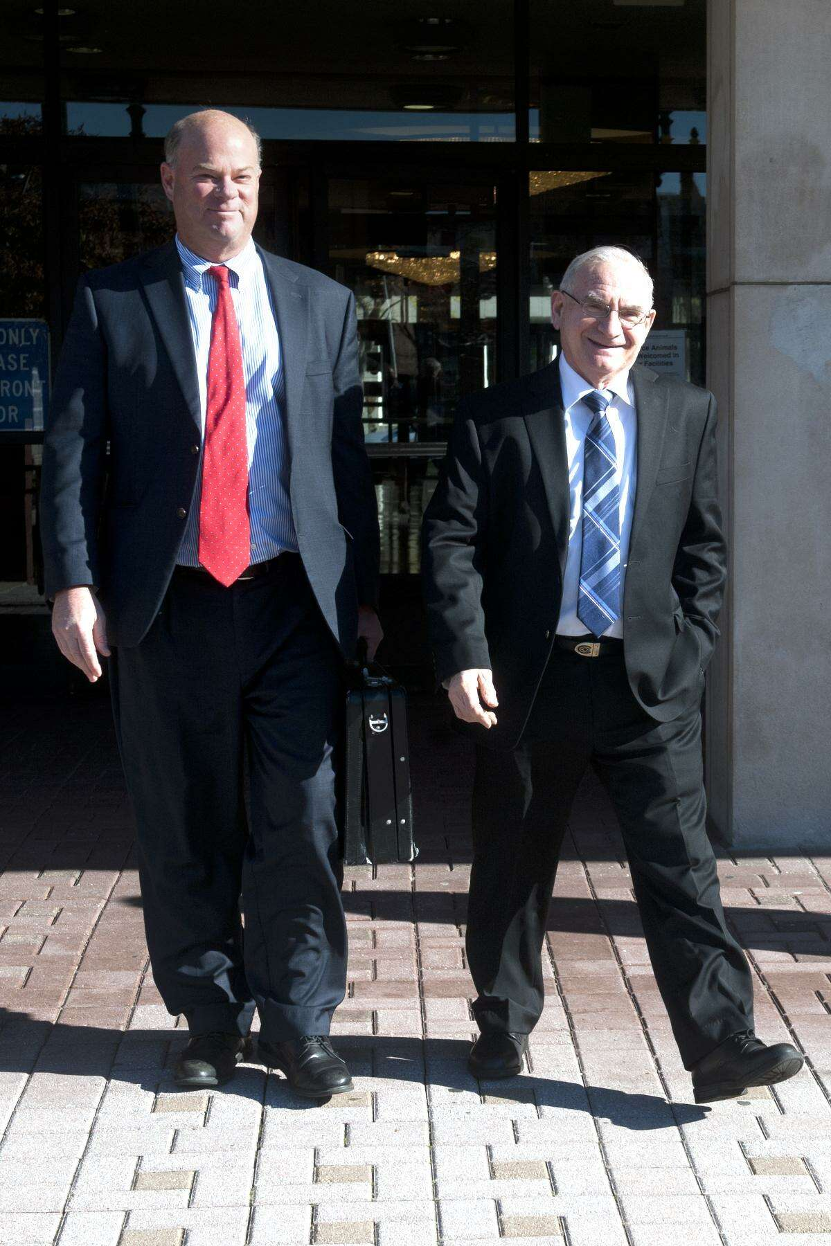Democratic Town Committee Chairman Mario Testa leaves Bridgeport Superior Court last Friday following the first day of a hearing challenging the results of the recent special primary in the 133rd City Council District in Bridgeport, Conn. Nov. 27, 2017. Testa is seen here with his attorney Robert Golger.