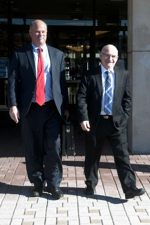 Democratic Town Committee Chairman Mario Testa leaves Bridgeport Superior Court last Friday following the first day of a hearing challenging the results of the recent special primary in the 133rd City Council District in Bridgeport, Conn. Nov. 27, 2017. Testa is seen here with his attorney Robert Golger. Photo: Ned Gerard / Hearst Connecticut Media / Connecticut Post