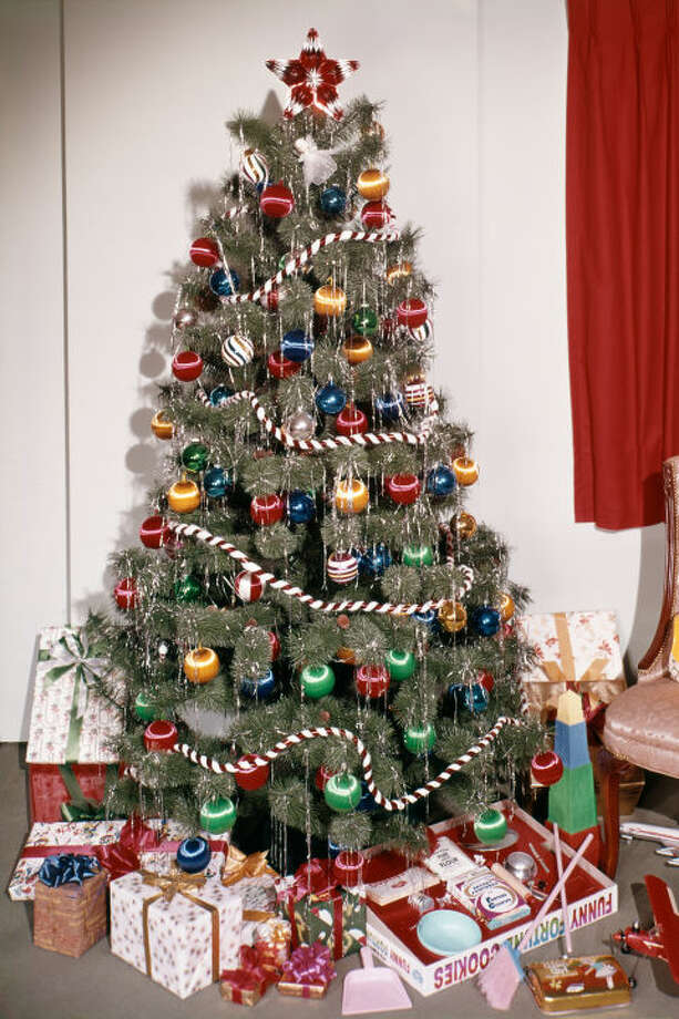 1) Tons Of Tinsel $5 BUY NOW A Tinsel Covered Christmas Tree, Like