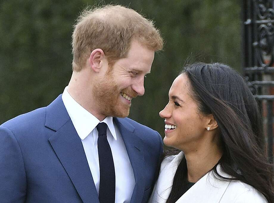 Britain's Prince Harry (left) and Meghan Markle smile as they pose for the media in the grounds of Kensington Palace in London, in November 2017. Photo: Dominic Lipinski, Associated Press