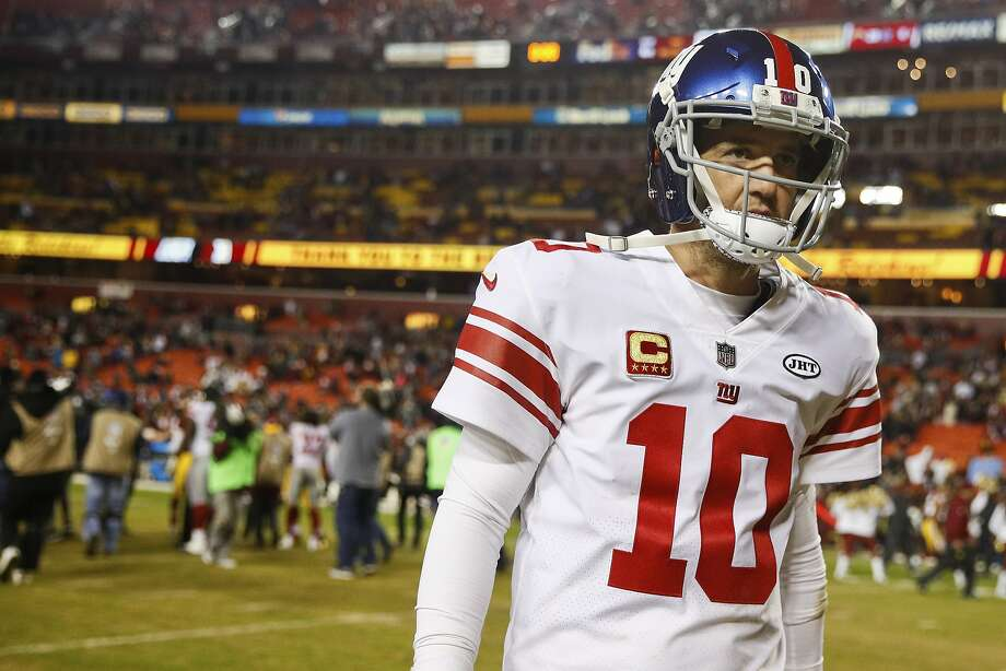 FILE - In this Nov. 23, 2017, file photo, New York Giants quarterback Eli Manning (10) walks off the field after a 2010 loss to the Washington Redskins, in an NFL football game in Landover, Md. The Giants are changing quarterbacks for first time in more than 13 years. Yes, Eli Manning is not going to start. The Giants announced on Tuesday, Nov. 28, 2017, that Geno Smith will start in place of Manning when the Giants (2-9) face the Raiders in Oakland on Sunday. (AP Photo/Patrick Semansky, File) Photo: Patrick Semansky, Associated Press