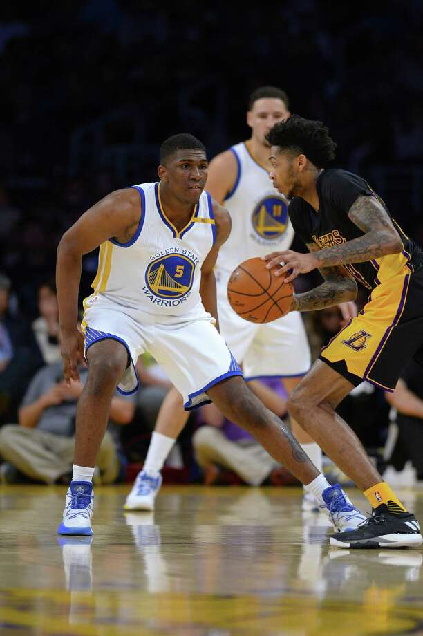 LOS ANGELES, CA - NOVEMBER 25:  Brandon Ingram #14 of the Los Angeles Lakers dribbles the ball against Kevin Looney #5 of  the Golden State Warriors on November 25, 2016 at STAPLES Center in Los Angeles, California. NOTE TO USER: User expressly acknowledges and agrees that, by downloading and or using this photograph, User is consenting to the terms and conditions of the Getty Images License Agreement. (Photo by Robert Laberge/Getty Images) Photo: Robert Laberge / Getty Images / 2016 Robert Laberge