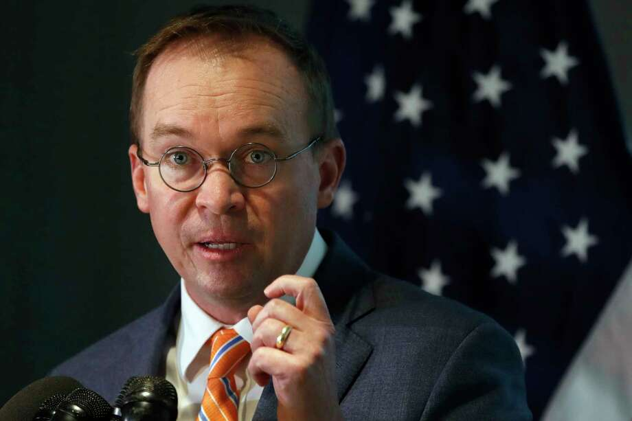 Mick Mulvaney speaks during a news conference after his first day as acting director of the Consumer Financial Protection Bureau in Washington, Monday, Nov. 27, 2017. (AP Photo/Jacquelyn Martin) Photo: Jacquelyn Martin, STF / Copyright 2017 The Associated Press. All rights reserved.