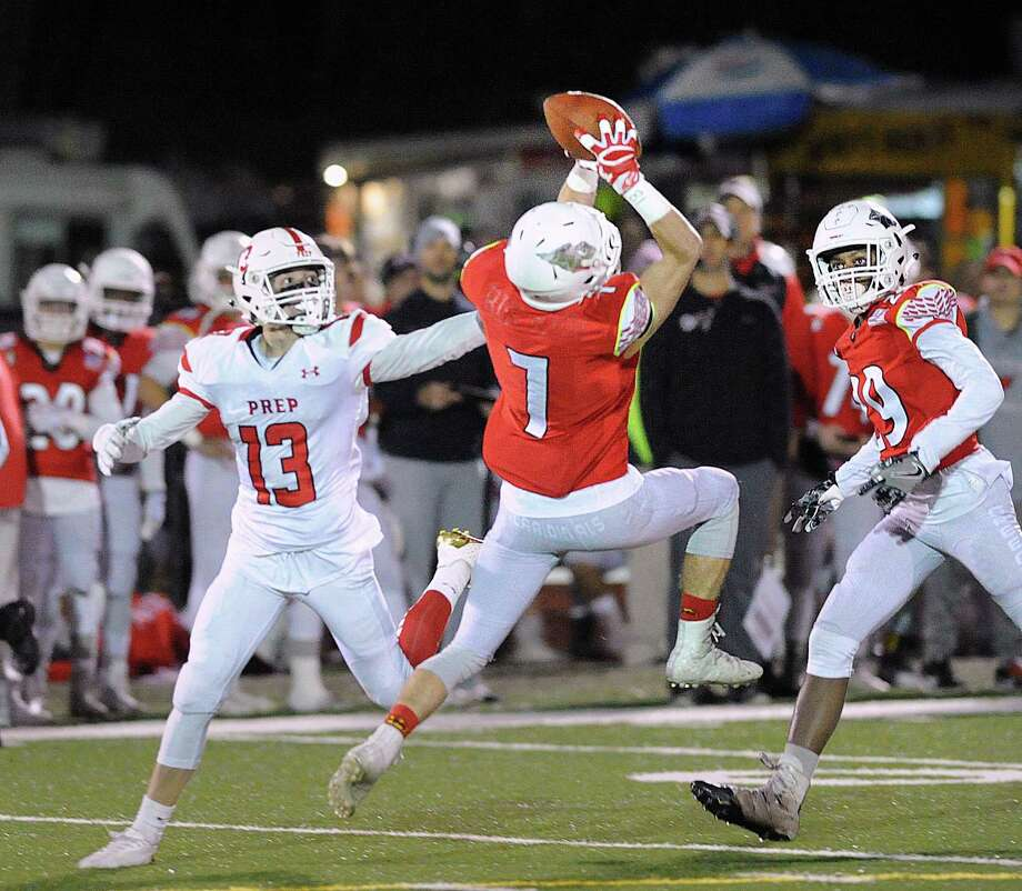 At center, Greenwich defender Charlie Ducret (#7) made an interception as he stepped in front of Fairfield Prep receiver Christopher Duffy (#13), at left, during the first quarter of the Class LL high school football playoff game between Greenwich High School and Fairfield Prep at Greenwich, Conn., Tuesday, Nov. 28, 2017. Photo: Bob Luckey Jr. / Hearst Connecticut Media / Greenwich Time