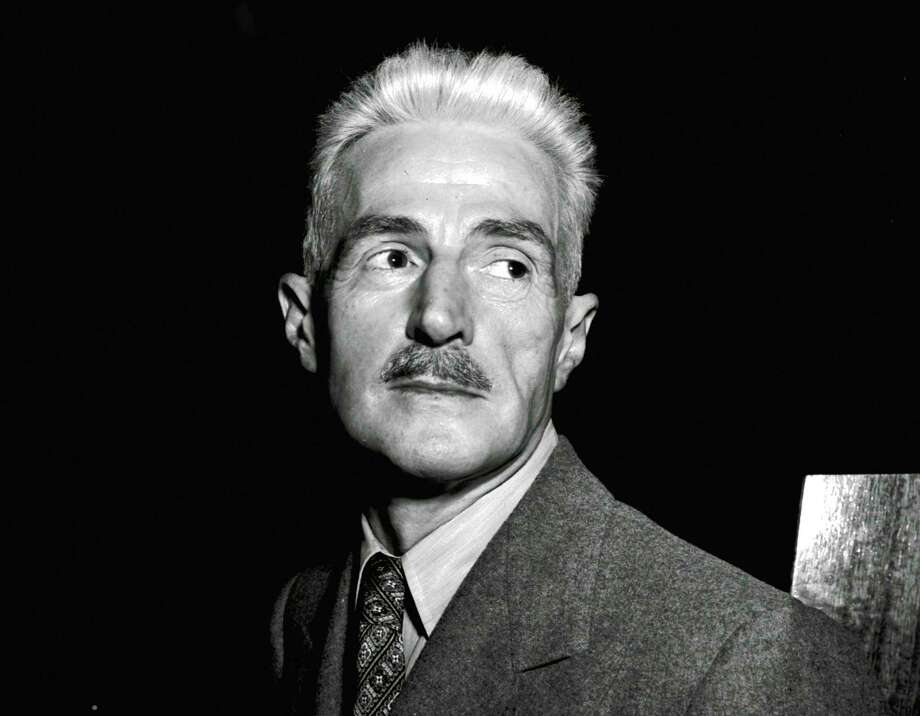 "FILE - In this Nov. 7, 1947 file photo, novelist Dashiell Hammett, author of ""The Maltese Falcon"" and ""The Thin Man,"" appears in New York. A Hammett story about a tormented killer is being published for the first time in more than 90 years. ""The Glass That Laughed"" first ran in the November 1925 issue of True Police Stories, a magazine which lasted just two years. It will run online Wednesday in Electric Literature (https://electricliterature.com). (AP Photo, File) Photo: STF / Copyright 2017 The Associated Press. All rights reserved."