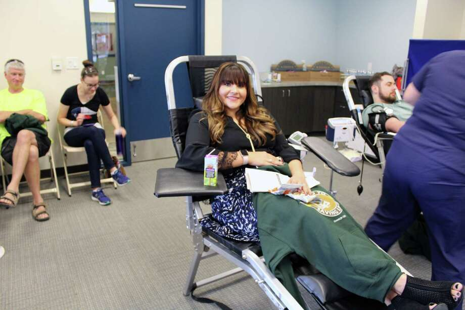 Jessica Beemer donates blood during the First Responders and Community Blood Drive at the Kingwood Community Center on Tuesday, Nov. 28. Photo: Melanie Feuk