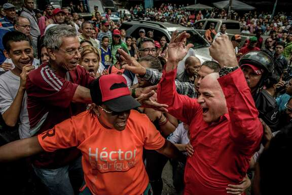 Venezuelan Maj. Gen. Manuel Quevedo, right, arrives to vote last month in Caracas. Venezuelan President Nicolas Maduro has named Quevedo to take over as oil minister and CEO of the national oil company, PDVSA.