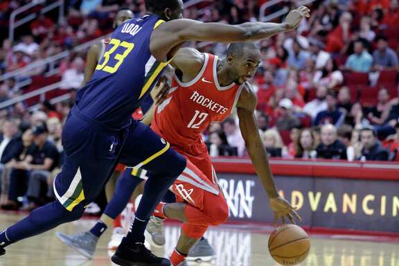 Rockets coach Mike D'Antoni has been pleased with the smooth transition of newcomers like Luc Mbah a Moute, right, over the first 20 games.