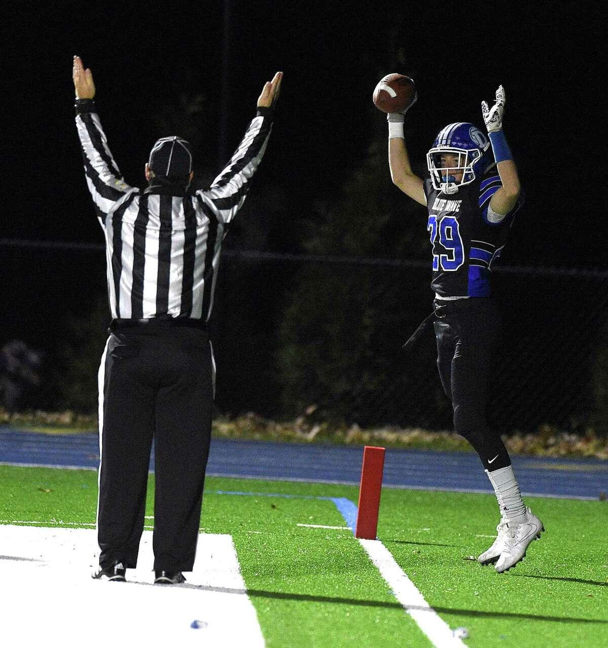 Darien Tyler Hergert (29) celebrates a touchdown against East Hartford in a CIAC Class LL football quarterfinal championship game at Darien High School on Tuesday, Nov. 28, 2017 in Darein, Connecticut.