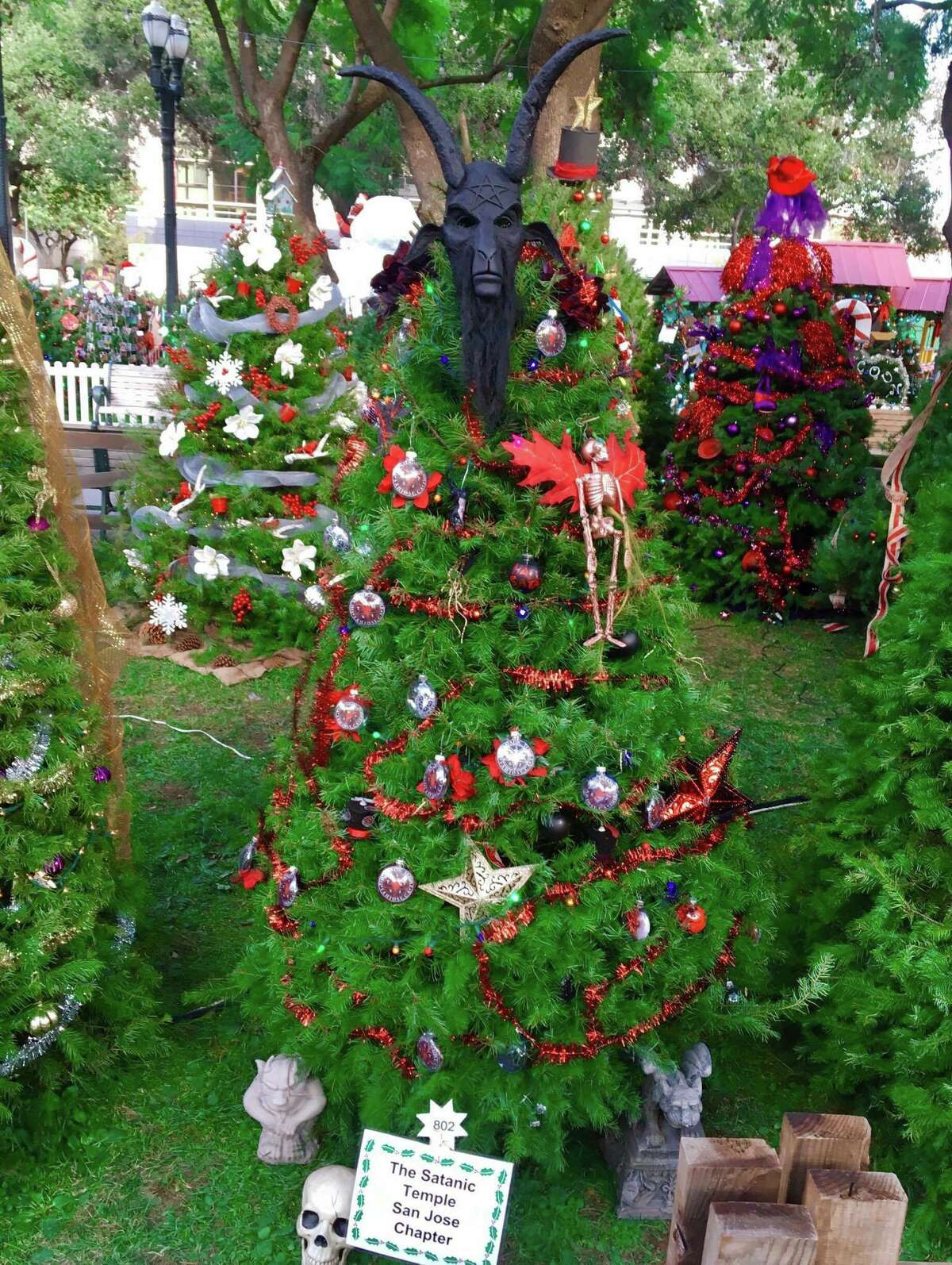 A tree decorated by the San Jose chapter of the Satanic Temple for Christmas in the Park had its goat mask tree topper stolen Saturday.
