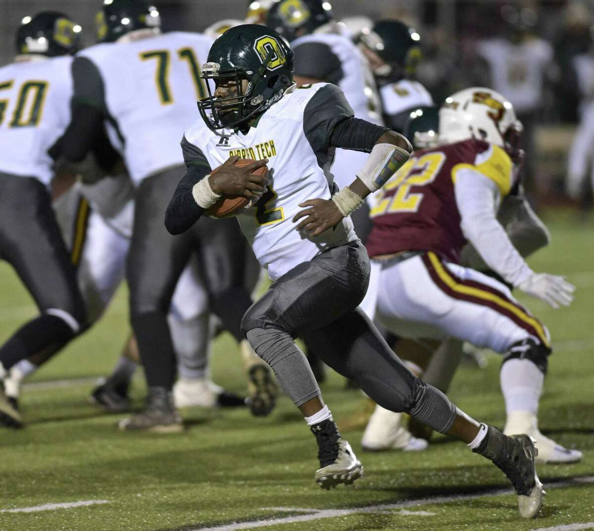 Tech's Jommar Roc (2) goes around the outside in the Class S football playoff game between O'Brien Tech and St.Joseph high schools on Tuesday night, November 28, 2017, at Trumbull High School, in Trumbull, Conn.