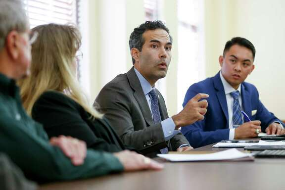 Texas Land Commissioner George P. Bush, center, talks to Fort Bend County residents and officials during a roundtable discussion Tuesday on the state of Hurricane Harvey recovery.